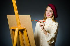 The funny artist working in the studio Royalty Free Stock Photo