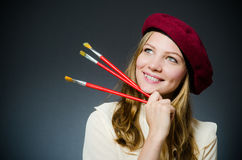 The funny artist working in the studio Stock Image
