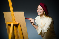 The funny artist working in the studio Royalty Free Stock Image
