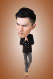Funny Asian big head man. Full length portrait Royalty Free Stock Photos