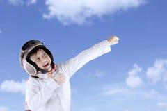 Funny Asian boy wearing vintage pilot helmet Stock Image