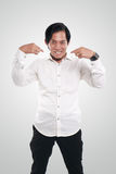 Funny Asian Businessman Pointing Himself Royalty Free Stock Images