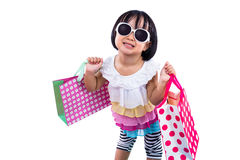 Funny Asian Chinese Little Girl Holding Shopping Bags Royalty Free Stock Photos