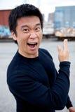 Funny Asian Karate Man. An angry asian man performing karate moves toward the camera Stock Image