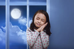 Funny asian kid sleeping on her hand in the home. At night stock photos