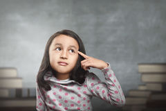Funny asian kid thinking for new inspiration. In the school Royalty Free Stock Images