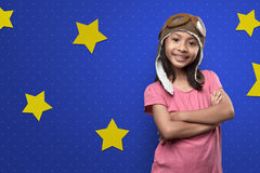 Funny asian little girl in astronaut costume standing Stock Photos