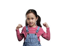 Funny asian little girl showing her hand muscles Stock Images