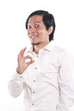 Funny Asian Man Showing OK Sign Stock Photo