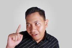 Funny Asian Man Thinking royalty free stock photography