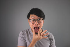 Funny Asian man is whipping. Royalty Free Stock Images