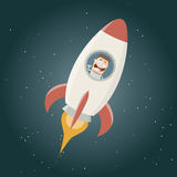 Funny astronaut flying in a space rocket Royalty Free Stock Photo