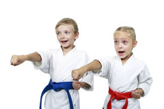 Funny athletes hit a punch arm isolated background Royalty Free Stock Images