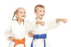 Funny athletes in kimono beat hand Stock Image