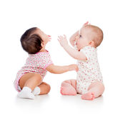 Funny babies children girls playing together Stock Image