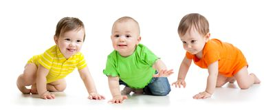 Funny babies crawling. Funny smiling babies toddlers crawling isolated on white royalty free stock photography