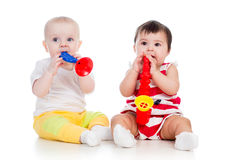 Funny babies girls play stock images