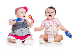Funny babies girls  play musical toys Royalty Free Stock Images