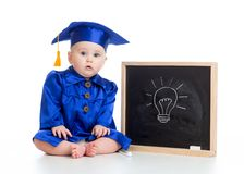 Funny baby in academician clothes at chalkboard Royalty Free Stock Photos