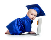 Funny baby in academician clothes using laptop Stock Image