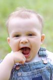Funny baby age of 9 months outdoors. Funny baby boy age of 9 months outdoors Royalty Free Stock Photos