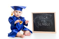 Funny baby with bell in academician clothes at Royalty Free Stock Images