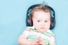 Funny  baby with big headphones Royalty Free Stock Photo