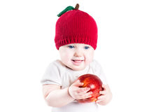 Funny baby with a big red apple Royalty Free Stock Photos