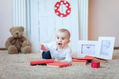 Funny baby with books Royalty Free Stock Photos