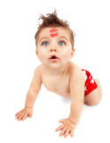 Funny baby boy. Image of funny baby boy crawling in studio, happy child with red kiss on the forehead isolated on white background, Valentine day, romantic Stock Photo