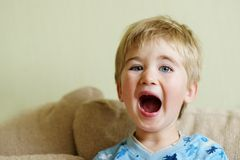 Funny baby boy. Picture of a baby boy yawning Stock Photography