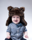 Funny baby boy  in a  brown fur hat . Royalty Free Stock Images
