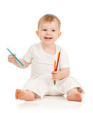 Funny baby boy drawing with color pencils. Funny baby drawing with color pencils Stock Photo