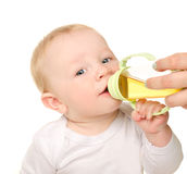 Funny baby boy drinking from bottle Royalty Free Stock Image