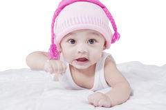 Funny baby boy with hat on bed Royalty Free Stock Image