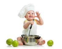 Funny baby boy with healthy food green apples Stock Photography