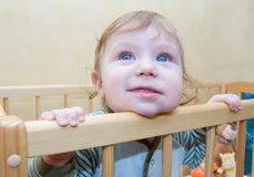 Funny baby boy looking curiously Royalty Free Stock Photos