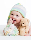 Funny baby boy lying on bed with plush toy Royalty Free Stock Photo