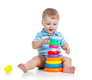 Funny baby boy playing with colorful toy Royalty Free Stock Image