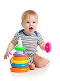 Funny baby boy playing with colourful toy Stock Image
