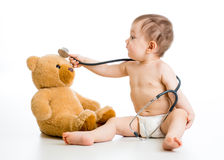 Funny baby boy playing doctor with toy stock photography