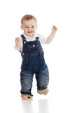 Funny baby boy is running. Studio shot. Royalty Free Stock Images