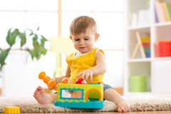Funny baby boy studying nursery room Royalty Free Stock Photos