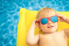 Funny baby boy on summer vacation stock photo
