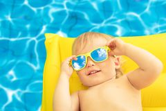 Funny baby boy on summer vacation stock image
