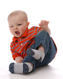 Funny baby boy tipping bottom in air stock image