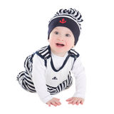 Funny baby boy toddler in sailor clothes crawling isolated on wh Stock Photo