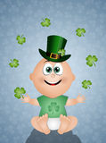 Funny baby with clovers Royalty Free Stock Image