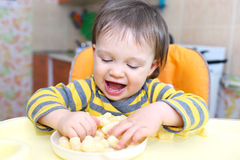 Funny baby with corn curls Royalty Free Stock Photography
