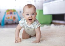 Funny baby crawling on floor at home stock photos